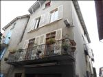 Appartement plus local commercial plein centre