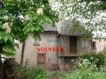 Dans petit hameau, maison en pierre comprenant cuisine, salon, 2 chambres