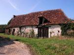Secteur EXCIDEUIL - Sur 355 m2, dans village, au calme, tres ancienne habitation + grange attenante