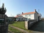 Une maison en pierre du 19ème siècle avec jardin clos et terrain séparé de 2.455 m²