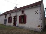 Maison partiellement rénovée avec 2 granges et champs