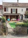 Agréable maison de village de 110 m² habitables avec garage, jardin ensoleillé et vues !