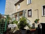 Maison de ville avec jardinet et garage